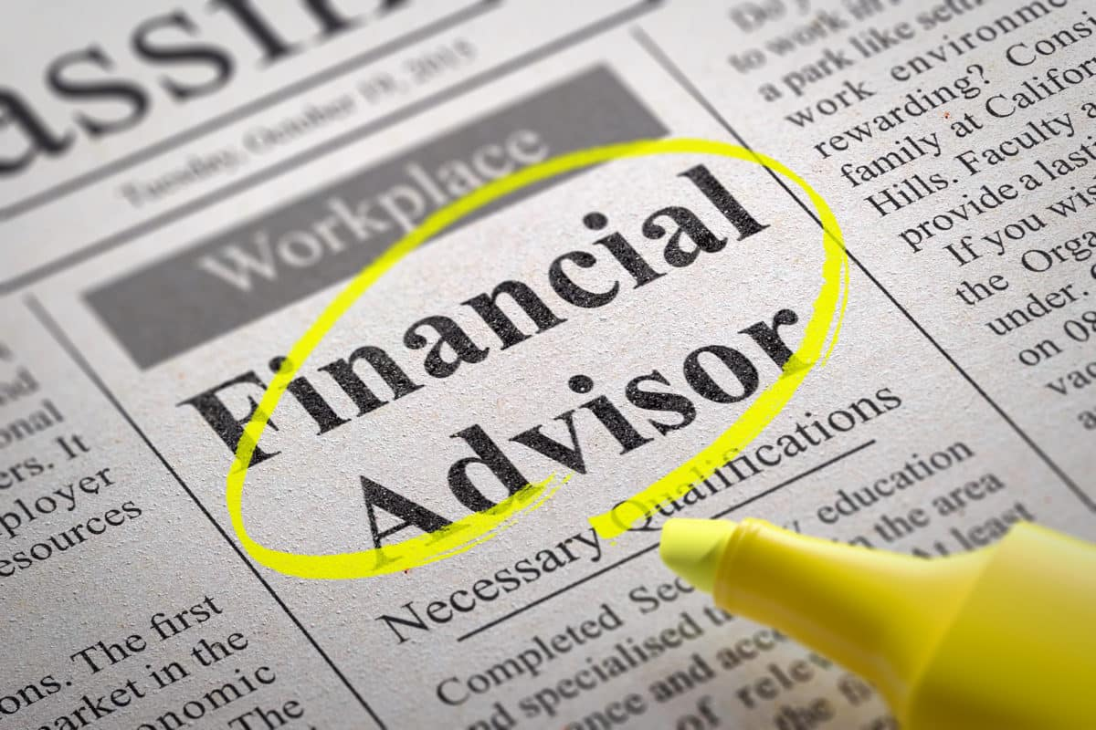 Financial Advisor Jobs in Newspaper. Job Search Concept.