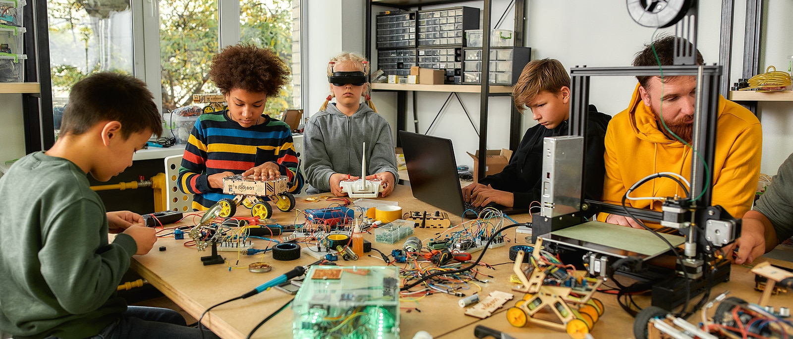 Young technicians building robots and vehicles