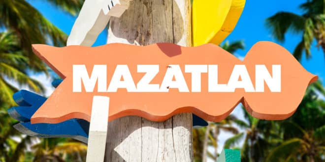 Mazatlan welcome sign with palm trees