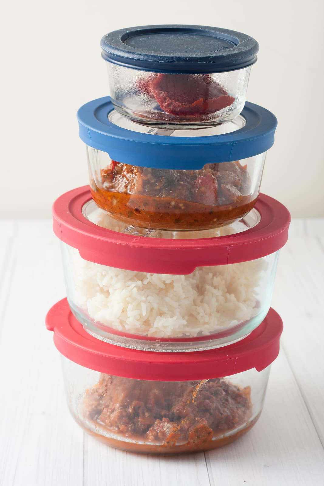 stack of glass containers with leftovers