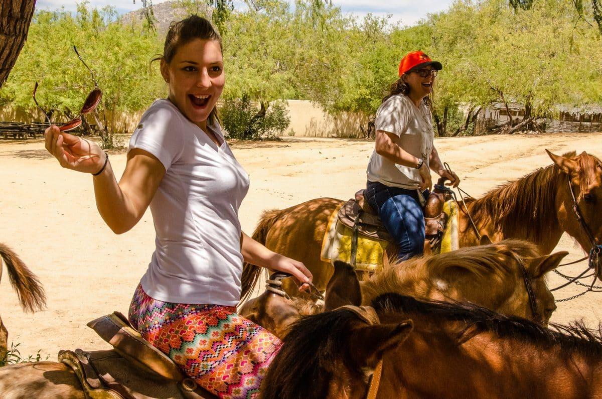 Young girl horseback riding in Cabo san Lucas