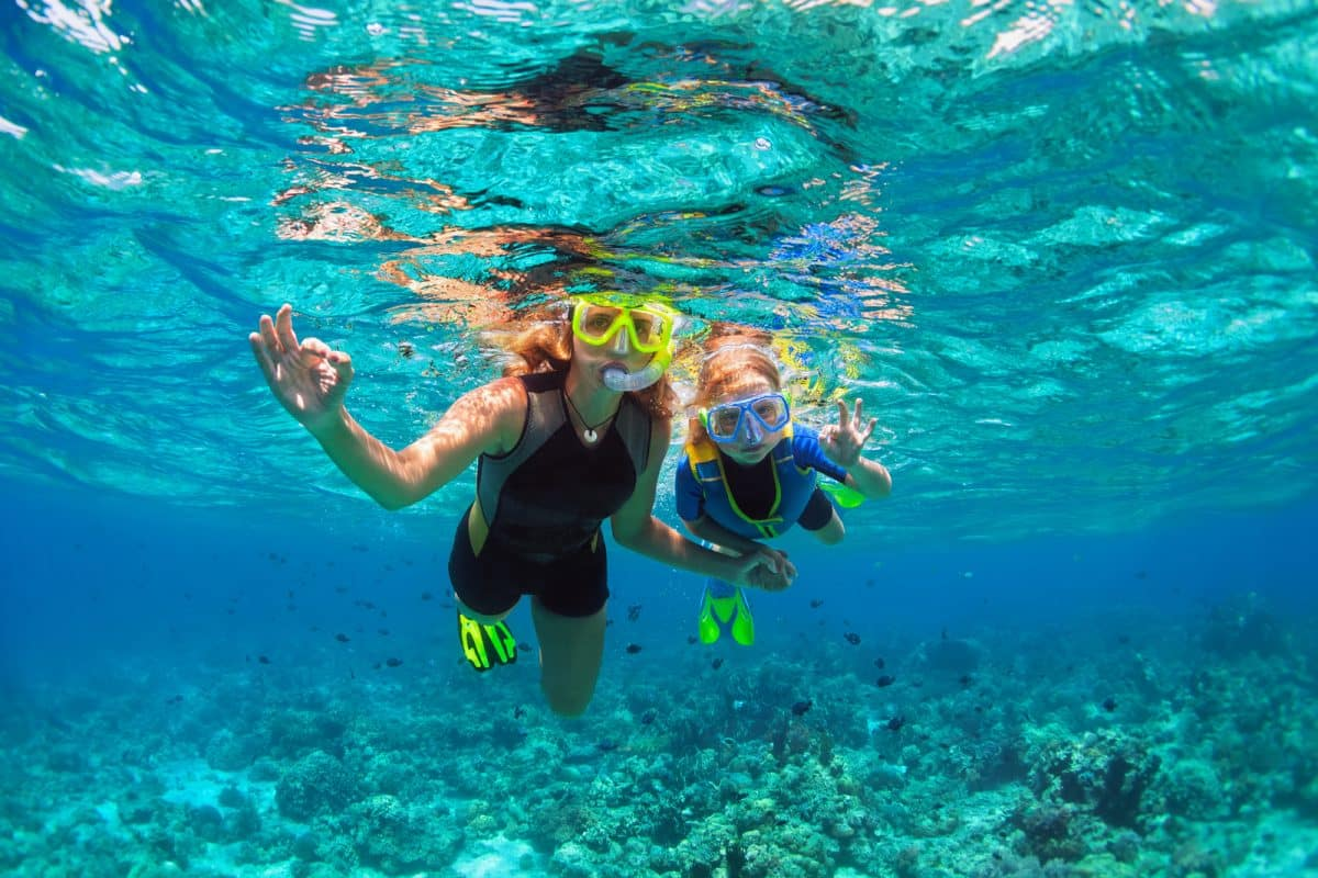 kid in snorkeling mask dive