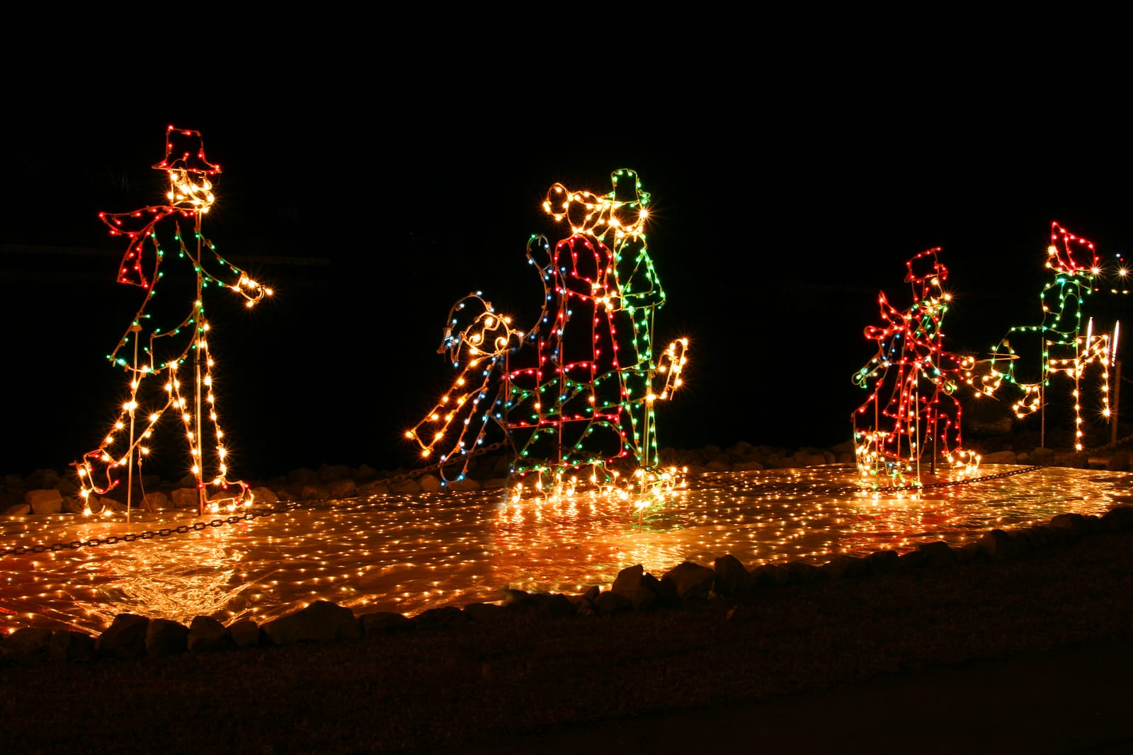 family of christmas lights skating on ice lights