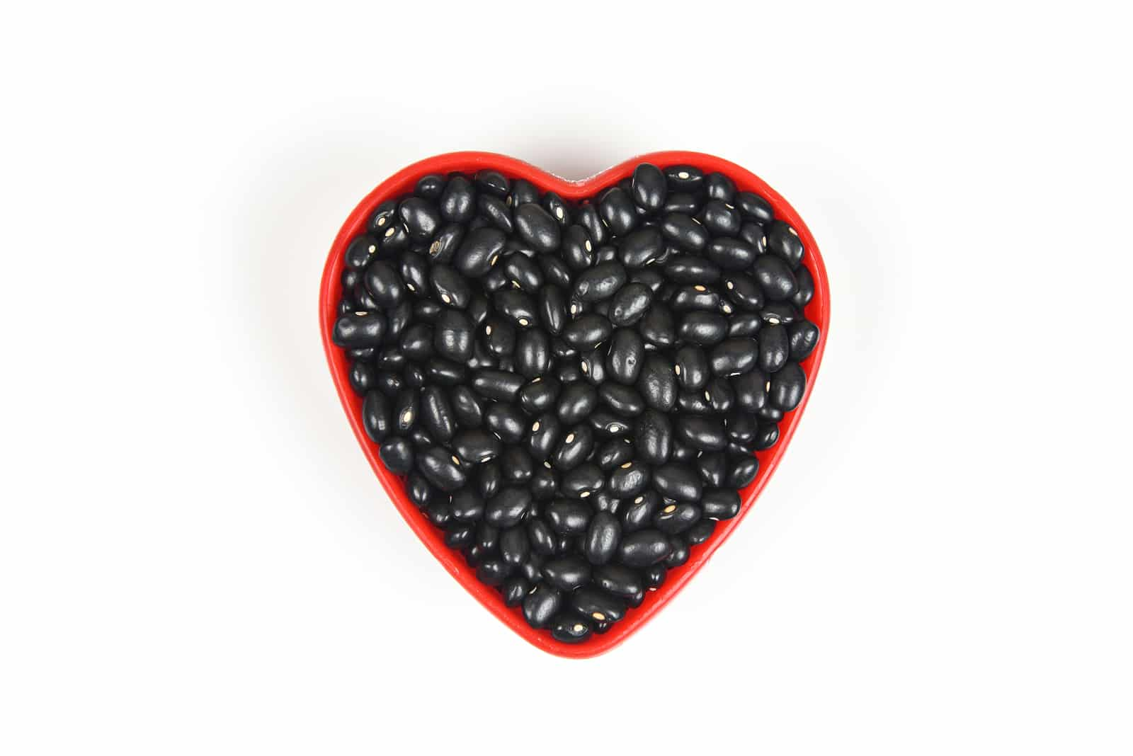 Black beans in red heart plate