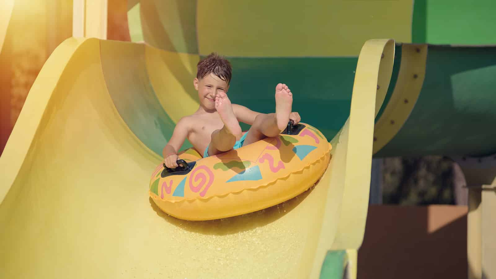 Boy having fun on the water slide