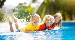 Kids play in swimming pool.