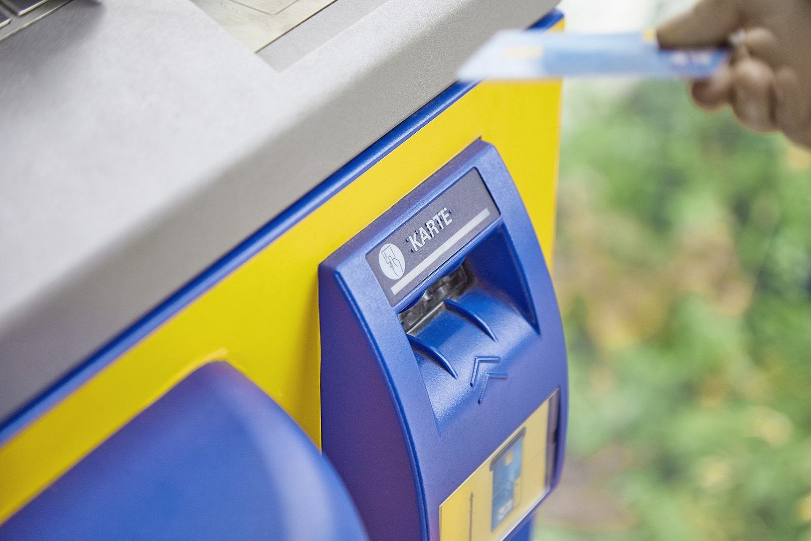 Close-up of an ATM system reading debit and credit bank cards