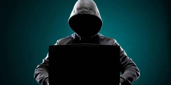 Computer hacker in hoodie.