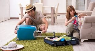 Young couple preparing for trip