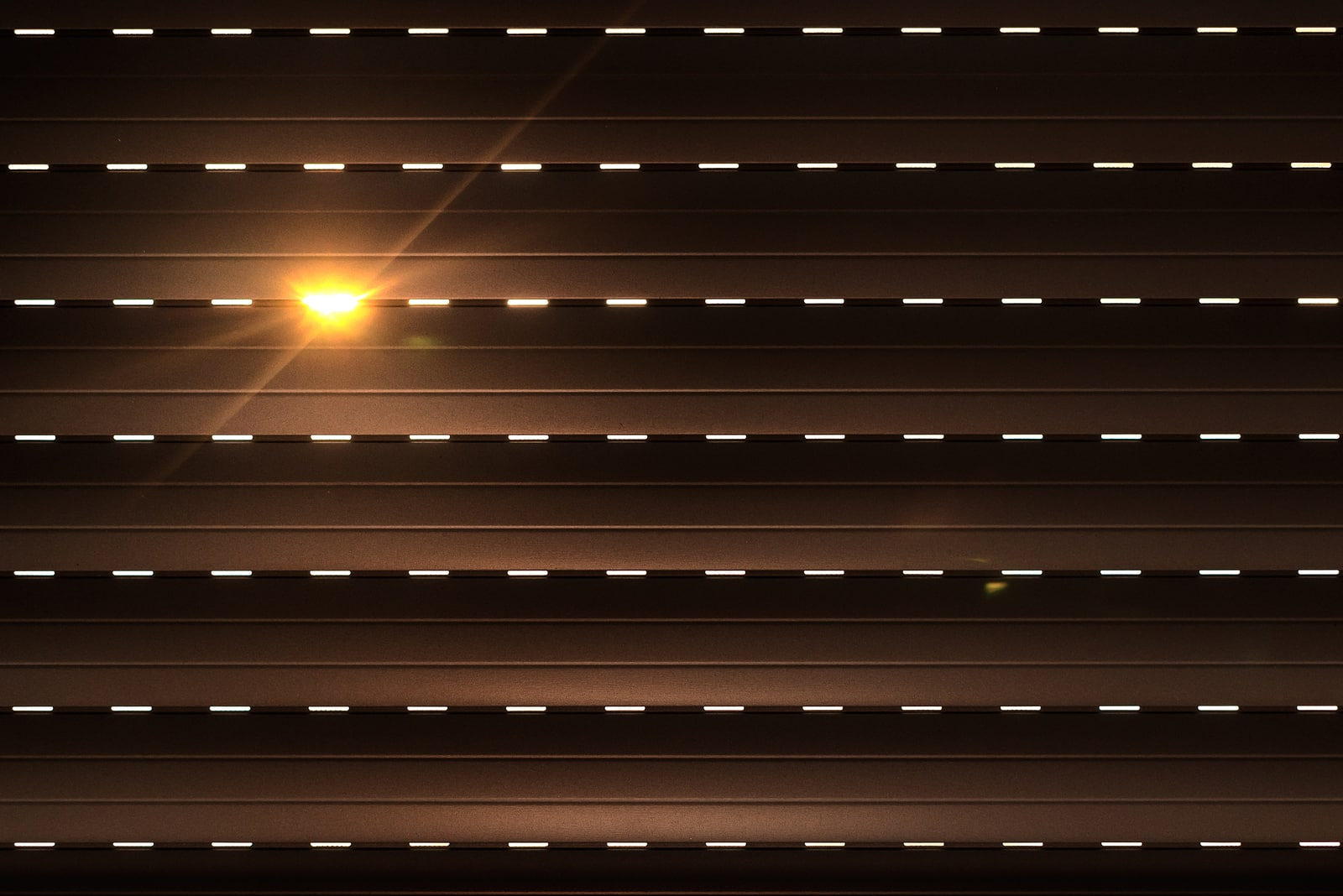 Shutters - blinds with sunlight in the morning