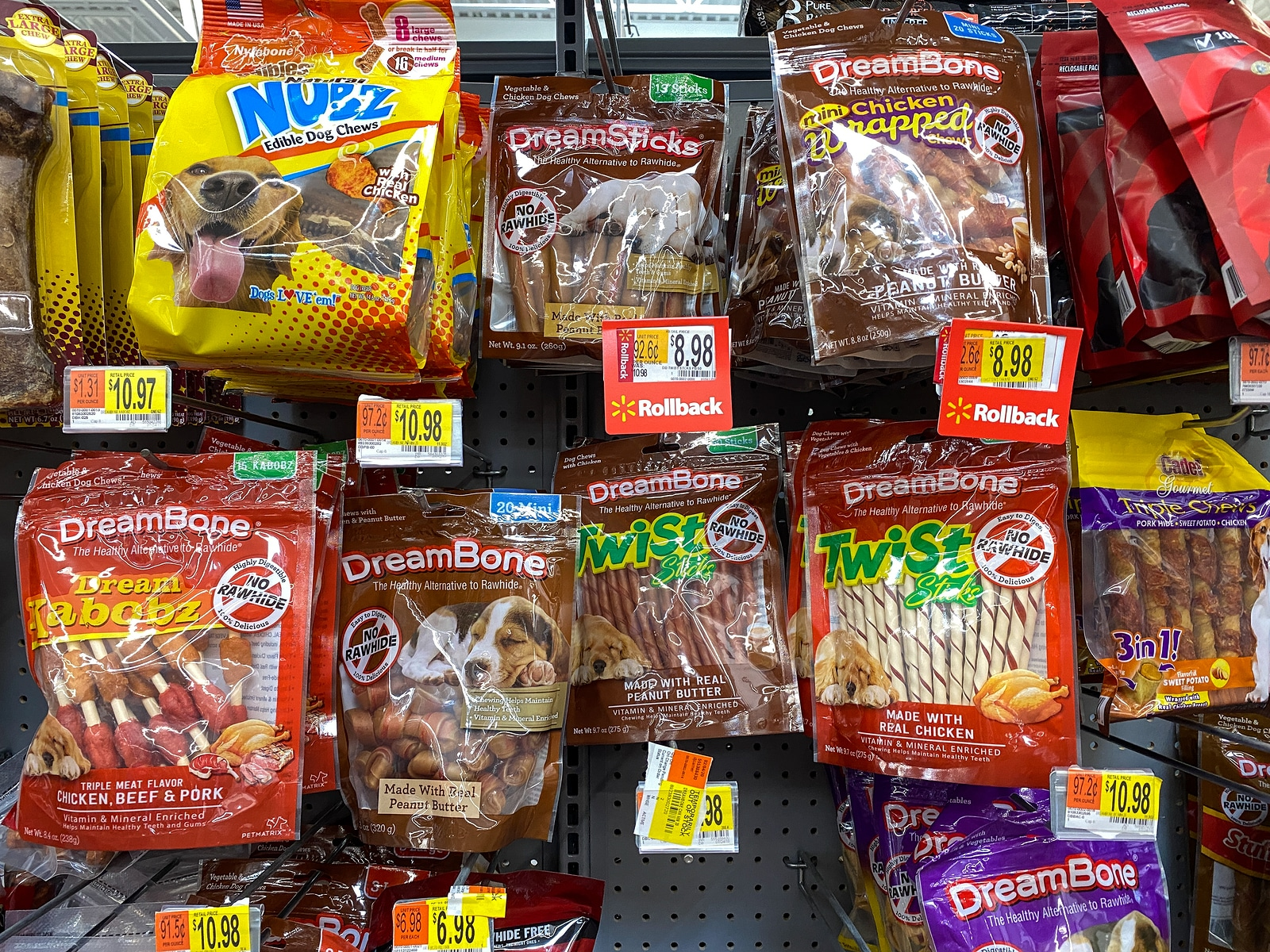 A display of a variety of dog treats in a Walmart
