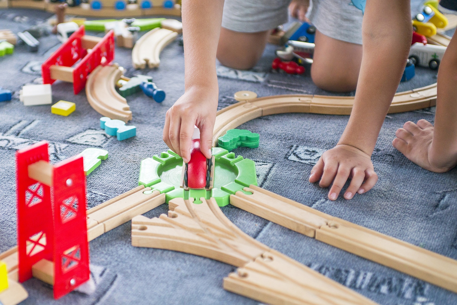 Children playing with wooden train